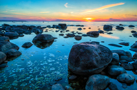Boulders in sea at sunset, Estonia