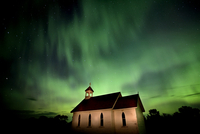 Green aurora over church