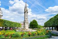 Monument in park in sunlight, Paris, France
