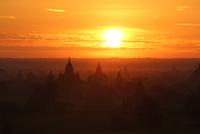 Silhouettes of buddhist temples at sunset, Bagan, Mandalay Region, Myanmar
