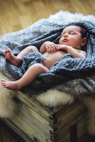 Portrait of newborn baby (0-1 month) sleeping in box