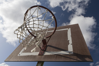 Basketball hoop against clouds