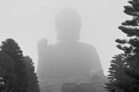 Buddha monument in fog, Lantau, Hong Kong, China
