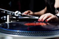 Female DJ with vinyl turntables