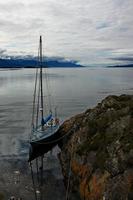 Sailboat moored on rocky coastline of Beagle Channel, Navarino Island, Argentina