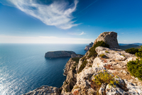 Majestic cliffs towering over calm blue sea, Sardinia, Italy