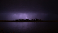 Lightning over lake at night, Victoria, Australia