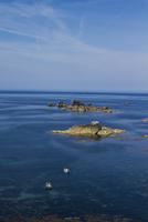 Sailboats near rocky islets at Lizard Point, Cornwall, England