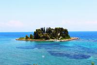 Blue sky over island, Pontikonisi island, Corfu, Greece