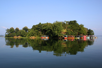 Boats moored in island on lake, Rangamati, Chittagong, Bangladesh