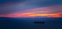 Sea and silhouette of ship at sunset, Vladivostok, Primorsky Krai, Russia