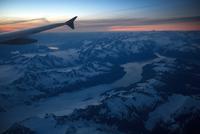 View from plane window at sunset, Alaska, USA