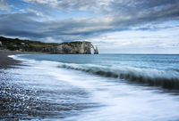Clouds over cliff and sea, Etretat, France