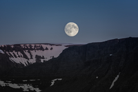 Full moon on sky over mountains, Westfjords, Iceland