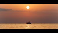 Silhouette of fishing boat at sunrise, Nei Pori, Greece