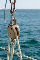 Old wooden pulley
