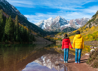 Young couple looking at mountains, White River National Forest, Aspen, Colorado, USA