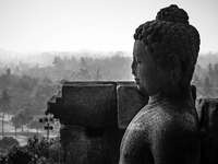 Buddha statue against townscape, Indonesia
