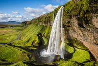 Splashing waterfall and mossy rocks, Seljalandsfoss, Iceland
