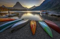 Canoes on lakeshore, Glacier National Park, Montana, USA