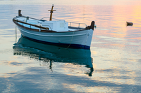 Fishing boat moored in sea at sunset, Greece