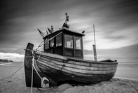 Old fashioned boat at sandy beach, Swinoujscie, Poland