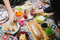 Two women having picnic on rug