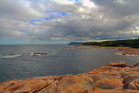 rocky coastline under cloudy sky, Ingonish, Victoria County, Cape Breton, Nova Scotia, Canada
