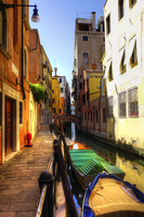 Venice - a small canal with boats at a pier