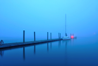 Lone Boat in the Morning Mist