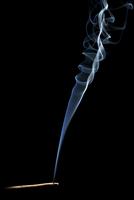 Studio shot of burning cigar with smoke