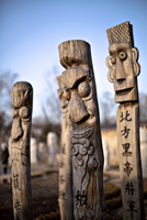 Traditional East Asian wood carved totem poles