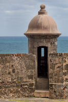 Stone turret in front of sea