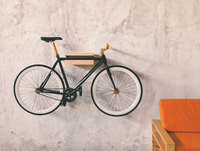Vintage bicycle hanging on grey wall