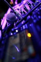 DJ mixer control panel and microphone