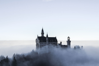 Palace above clouds under clear sky