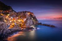 Mediterranean old town on seashore at dusk