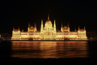 Neoclassical parliament building at night