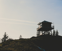 Wooden tower on hill at sunset