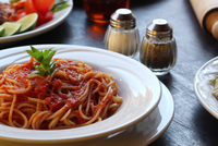 Spaghetti with sauce on plate