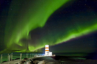 Northern lights (Aurora borealis)  over lighthouse