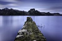 Stone pier in lake