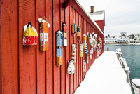 Red boathouse with colorful handles