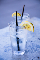 Cold water with ice cubes and lemon slice