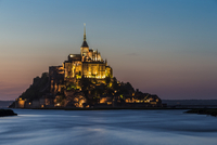 Mont St. Michel monastery on island at sunset, Normandy, France