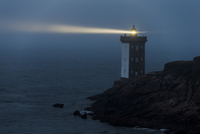 Lighthouse at night on seashore
