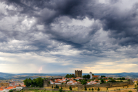 Dramatic clouds over walled old town