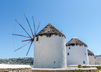 Cycladic architecture windmills under clear sky, Greece
