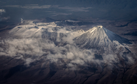 Aerial view of snow-capped volcano and mountains