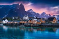 Scandinavian fishing houses on seashore at sunset